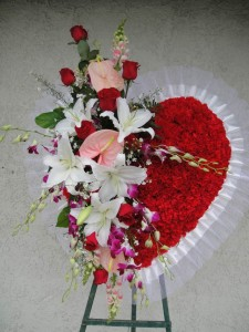 Solid Red Carnation and Casablanca Lily Heart Shape Spray