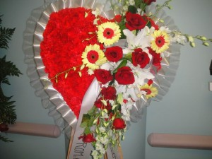 Carnation Filled and Popping Yellow Daisies Heart Shape Spray