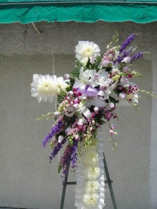 Purple Roses and Lavender Fiji Chrysanthemum Centered With White Lilies Standing Cross
