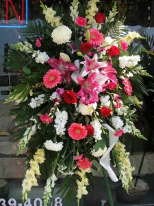 Pink Daisies and Lilies, Red Roses, and White Chrysanthemum Standing Spray